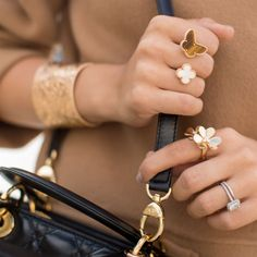 Girl Meets Glam picked out this beautiful yellow gold multi-finger ring from Van Cleef & Arpels' Vintage Alhambra collection and matched it with a Perlee cuff in rose gold while in Paris. Lucky girl! Photo: Girl Meets Glam #LoveGold