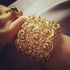 A close up shot of Coco Rocha's beautiful gold cuff by Azva. #lovegold