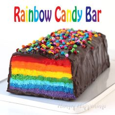 Cut into this chocolate covered nougat bar to reveal brilliantly colored layers of red orange yellow green blue indigo and purple. This Giant Rainbow Candy Bar will brighten anyone's day. Rainbow Candy Bars, Giant Candy Bars, Easy Homemade Desserts, Homemade Candies, Homemade Chocolate, Chocolate Recipes, Rainbow Donut, Rainbow Cakes, Rainbow Food