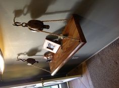 Weekend project, made a hanging shelf from a slab of teak and some old barn pulleys.