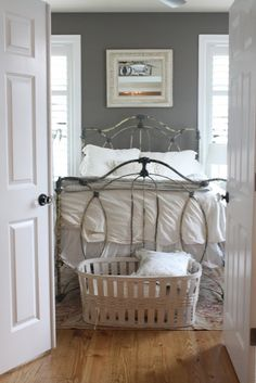 slate grey paint looks great on walls with white trim and hardwood. Add some pink accents for a nice spare bedroom