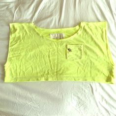 Abercrombie & Fitch neon yellow crop top size XS This is a neon yellow Abercrombie & Fitch crop top that is 60% cotton and 40% polyester. It is super comfortable and is great for working out and having the 80s look. It is in excellent condition and has a moose embroidered. If you have any questions please ask! Abercrombie & Fitch Tops Crop Tops