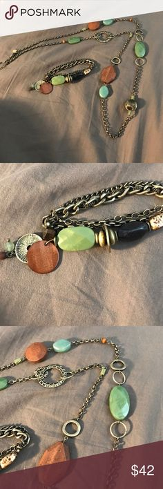 Lia Sophia necklace and bracelet set green brown Lia Sophia necklace and bracelet set green brown and copper.  Necklace is 20 inches long and has room for extension.  In perfect condition! Lia Sophia Jewelry Necklaces