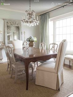 Love the blend of dark wood, painted and fabric chairs
