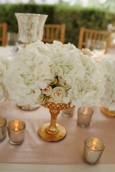 27 best cream and white flowers images on pinterest floral alternative centerpiece option gold compote vase filled with white hydrangeas and light pink spray roses and surrounded by gold mercury glass votives mightylinksfo