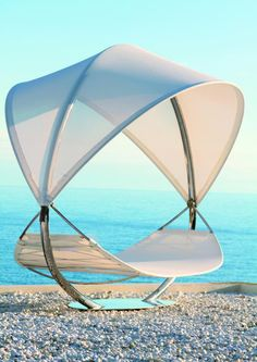 Botania SURF Lounger doubles is a sculptural work of art. Designed by Kris Van Puyvelde, the SURF is the new luxurious hammock based on the specific WAVE hammock from Royal Botania in 2008. This alluring chair is combination of functionality, beauty and elegance.
