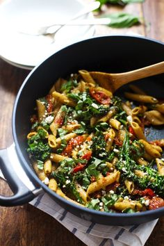 20-Minute Lemon Pesto Penne - baby broccoli, oven roasted tomatoes, pesto, fresh lemon, feta, and basil. My husband says it's his new favorite! 350 calories. | pinchofyum.com