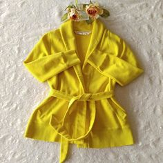 🎉HP🎉J. Crew//Sweater 🎉HPx5🎉  🎉Girly Girl Party🎉 8/24/16 🎉PoshLoveFest/Fall Fashion Partyx2🎉 12/6/16 🎉Wardrobe Wish List Party🎉 12/18/16  Adorable yellow J. Crew Sweater with tie around the waist. The collar folds down around the neck, two pockets on the side. Material: 86% Cotton,  14%Polyester   ▪No Trades ▪This closet welcomes reasonable offers ▪10% off 2+bundles J. Crew Tops Sweatshirts & Hoodies