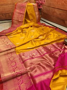 This is a pure classic collection in Banarasi range. A orange golden color with crimson red pallu that has a thorough zari weave in the border and all over the body. The zari motif weaves an elegant geometrical pattern to give it a pumped up appearance.