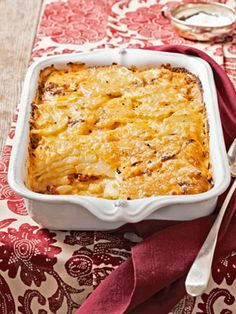 Crushed chile flakes and roasted red peppers contribute spicy punch to this creamy potato gratin, inspired by pimento cheese — often called Southern pate.  Recipe: Pimento-Cheese Potato Gratin   - CountryLiving.com
