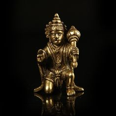 The half kneeling pose of deities and disciples means acknowledging the greatness and supremeness of the power in front of whom one kneels. This tiny table-top piece of art makes for a beautiful and a meaningful gift as well as home decoration.  http://www.indiancraftsmen.com/home-decor/brass-amp-mosaic/brass-hanuman-3