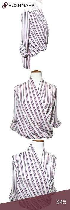 Romeo & Juliet Couture High Low Faux Wrap Blouse Romeo & Juliet Couture faux wrap blouse. White lightweight crepe fabric with bold pink and navy stripes. Blousy front fit, high low hem. Long sleeves with roll tabs. Love this blouse when paired with skinny jeans and heels. Like new condition. Romeo & Juliet Couture Tops Blouses