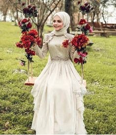Image may contain: 1 person, standing, flower and outdoor dresses vintage bridesmaid veiling Clothing Suggestion Page on Instagr . Modest Fashion, Hijab Fashion, Fashion Dresses, Vestidos Vintage, Vintage Dresses, Hijab Mode, Muslim Wedding Dresses, Wedding Outfits, Dress Wedding