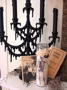 plain candelabra with gluegun drips, spray it black, or paint it red to look like blood, or green, maybe use some iridescent glitter?