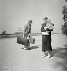 "November 1936. ""Young family, penniless, hitchhiking on U.S. Highway 99 in California. The father, 24, and the mother, 17, came from Winston-Salem, North Carolina. Early in 1935 their baby was born in the Imperial Valley, California, where they were working as field laborers."""