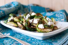 Sauteed Brussels Sprouts With Goat Cheese (saute with olive oil, salt & pepper, and cayenne pepper)