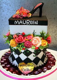 Incredible shoe and shoe box cake! Looks like there was some MacKenzie-Childs inspiration! (great idea!)