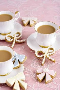 Coffee in beautiful cups w/pretty biscuits! Tea time!!