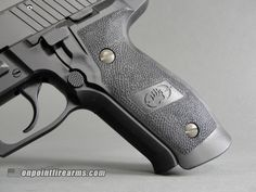 Sig Sauer P226 Blackwater Limited Edition 9mm w/ two 20rd magazines.
