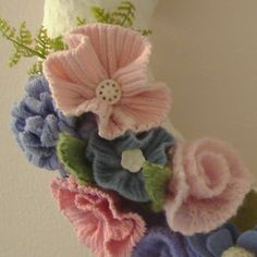 No pattern, but a great idea for a soft wreath.