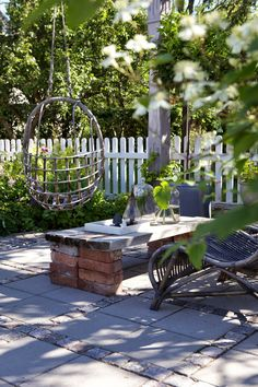 What do you like most from this outdoor space: 2) the hanging chair or b) the table and decor?