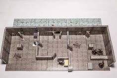 Zenithal view of a 20 X 8 inches tavern. There are place enough to start a bar-room brawl and get away before nobody realize. Just be sure not making angry somebody too dangerous.