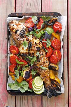 Marinated grilled fish with tomato and mango salsa  • 1 fresh fish, about 1kg  • 45ml oil  • 30ml soya sauce  • 1 thumb-sized piece ginger, grated  • 3 large cloves garlic, finely chopped  • 1 red chilli, pitted and finely chopped  • 30ml sugar  • 10ml salt