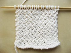 This is a cute, simple basketweave stitch that would look cute as a purse, pillow, or whatever else you want to make.  follow the link for a picture tutorial. Credits to Michele Arnwine for finding this site.