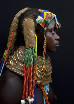 Mumuhuila Hairstyle - Angola - The hairstyle is made of dried cow dung, herbs, roots, oil & fat. The number of dreadlocks has a meaning: 3 dreadlocks means there are dead people in the family, 4 to 6 dreadlocks is the normal style.