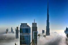 Skyscrapers gleam among the fog in Dubai