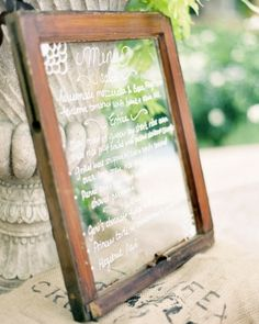 This menu, written on a vintage window frame, fits in perfectly with natural decor and a beach setting