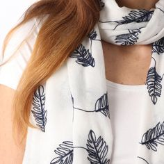 Ladies' White scarf with navy embroidered leaves, by Style Slice, features a pattern of leaf embroidery. Elegant spring or summer shawl that can be personalised with a charm or a monogram. Suitable as a gift for anniversary, birthday or any day in which to tell the woman in your life, be it a Mum, Wife, Sister or Girlfriend, that she is special. #scarf #shawl #wrap #scarves #fashion #vintage #handmade #accessories #etsy #gift #feather #leaf #headwrap #ootd #personalized