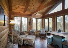 A sunroom is a great way to experience nature without worrying about insects, humidity, or uncomfortable temperatures. In this log home sunroom by Hochstetler Log Homes, a cathedral ceiling, exposed beams, and plenty of windows provide an open, airy feeling. #loghomes #logcabins #sunrooms