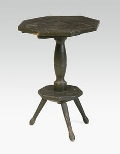18th c. painted tripod type candle stand.  google.com