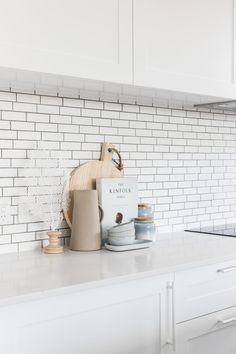 Subway tiles with a dark grout, shaker style cabinets, white handles to match the doors. Subway tiles with a dark grout, shaker style cabinets, white handles to match the doors. Refacing Kitchen Cabinets, Modern Kitchen Cabinets, Kitchen Countertops, Kitchen Decor, Rustic Kitchen, The Doors, Kitchen Splashback Tiles, Kitchen Subway Tiles, White Subway Tiles