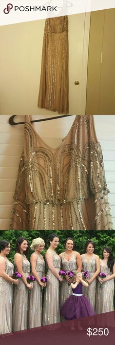 Adrianna Papell Size 10 Dress Size 10 floor length dress. It has a light pink underbody with a tan gossimer that has gold beads and sequins. Its 54 inches from shoulder to the bottom. It was worn once for my sisters wedding! Adrianna Papell Dresses Prom