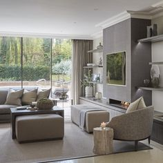 Tv area in the Wentworth project, note how the tv shelving lines up perfectly with the row of mature olive trees in the garden- so pleasing to the eye. #insideoutside #interiordesign #olivetrees #livingroom #lounge #luxuryhomes #SophiePatersonInteriors #wentworth