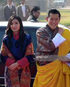 King of Bhutan, Jigme Khesar Namgyel Wangchuk (R) and Bhutanese Queen Jetsun Pema Wangchuck arrive for the welcome ceremony at the Presidential Palace in New Delhi on January 25, 2013.  The King of Bhutan is in the country on a seven-day state visit and will be the chief guest at India's 64th Republic Day military parade on January 26.  AFP PHOTO/RAVEENDRAN        (Photo credit should read RAVEENDRAN/AFP/Getty Images)