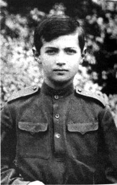 Young successor of Czar of all Russia~ Alexei posing in the gown of Russian soldier, he is 11 years old here. 1915.