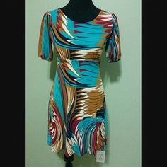 Bold colors dress Beautiful dress ties in the back. Mid sleeves. Fits right above the knees. Dresses