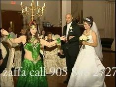 Amir is Egyptian and we love the idea of leading the couple in with a traditional Egyptian-style zaffa, complete with shamadan. Great example of a classic zaffa by the Arabic Dance Group! - maybe best for the Rehearsal Dinner?