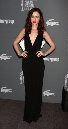 Cool Hot Hollywood Celebrity Lily Collins looks super skinny at the Costume Designer Guild awards links .   4 Hi-Resolution images in gallery.