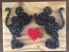 Disney Mickey Mouse and Minnie Mouse silhouette with heart string art black and red string on wooden board