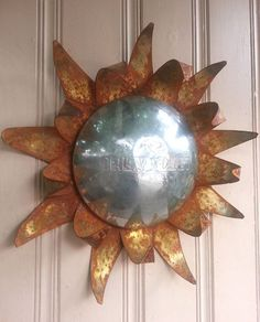 Chevy hubcap sunflower or sun rusted metal wall by MyRustedRoots, $79.00