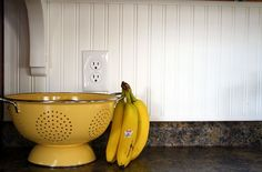 use colorful strainer as fruit bowl...free up a little cupboard space. Every bit counts