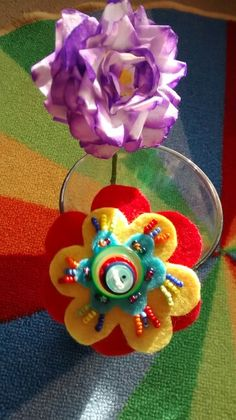 Flower made from coffee filter papers with felt tips and felt with beads & buttons