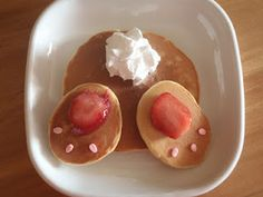 """Bunny Bottom Pancakes.  Make a regular round pancake and two smaller more oval pancakes for each bunny.    Put a slice of a strawberry to each foot. Then add 3 egg shaped sprinkles to complete the """"pads"""" on the bunny feet. You could also use chocolate chips for the pads of the feet.    Add a spritz of whip cream to make the cotton tail."""