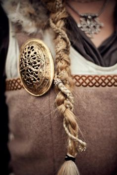 Great idea - take beads w/ Pearls and/or Swarovski  crystals (Pandora, or similar), add either onto braid or smooth section of hair, twist & weave into an updo for wedding or special occasion.   Viking costume.