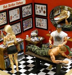 """Perhaps the most detailed diorama at the show was this superb 1:6 scale recreation of the """"Bad Mother Tattoos"""" tattoo parlor. Note all the t..."""