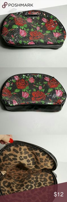 "Sequined Betsey Johnson Cosmetics Bag This bag is a med. Sized that zips closed on top and is super stylish and fun Betsey Johnson Make up Bag with pink and Red roses on a black background.  Was used for make up only. Measures 10""w x 7"" Tall.   Has a lot of life left for one lucky buyer! Betsey Johnson Bags Cosmetic Bags & Cases"